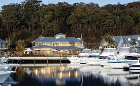 Anchorage Port Stephens New South Wales and Sydney exterior white building near a marina with boats