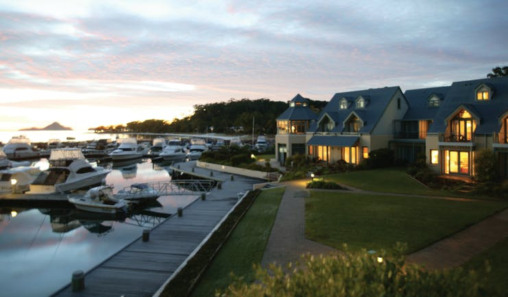 Anchorage Port Stephens New South Wales and Sydney grounds buildings next to a marina with boats