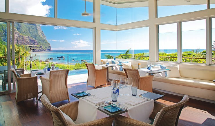 Capella Lodge restaurant, elegant and modern interiors, views overlooking bay and mountains