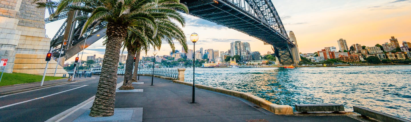 Sydney Harbour Bridge over the harbour, cityscape in background