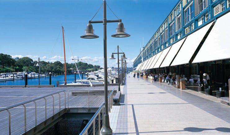Ovolo Woolloomooloo Sydney exterior marina view of building with awnings next to a marina