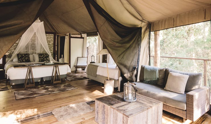 Paperbark Camp New South Wales king lounge tent with bed and sitting area with sofa