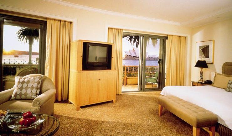 Park Hyatt Sydney bedroom terrace with armchair with view of Sydney opera house