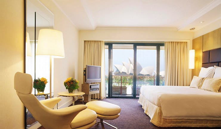 Park Hyatt Sydney bedroom with leather recliner and view of Sydney opera house