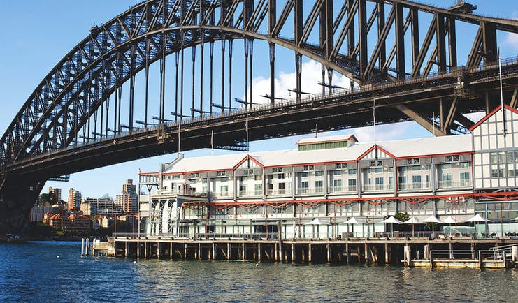 Pier One exterior, hotel building with balconies, sydney harbour bridge, harbour water
