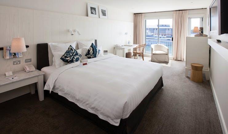 Pier One waterside room, king size bed, elegant decor, balcony overlooking harbour