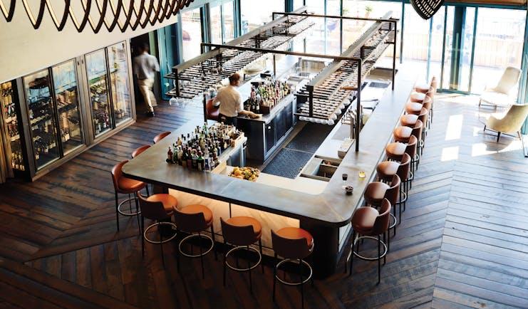 Bar area with high stools around the rectangular bar