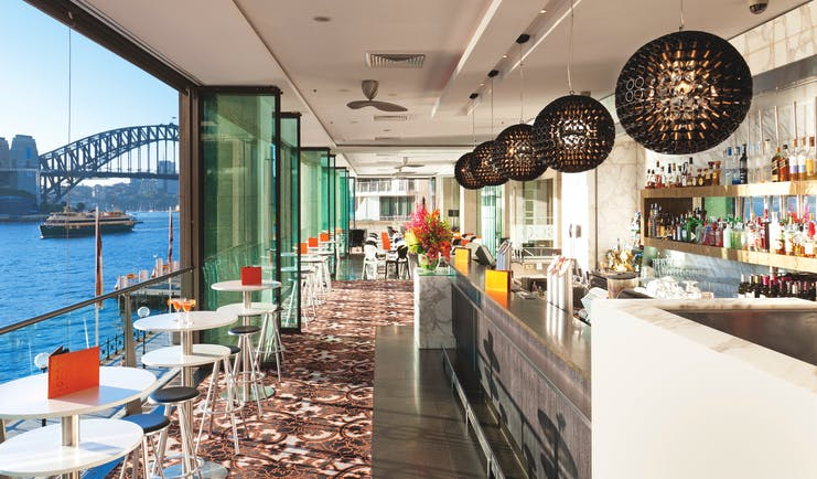 Pullman Grand Quay Sydney bar daytime with view of harbour bridge