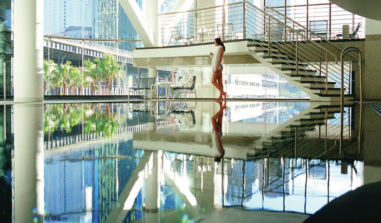 Pullman Grand Quay Sydney indoor pool with large glass windows