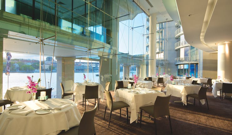 Pullman Grand Quay Sydney restaurant with floor to ceiling windows and harbour view