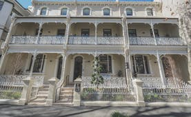 Spicers Potts Point exterior, a large cream building with arching windows and white balcony railings