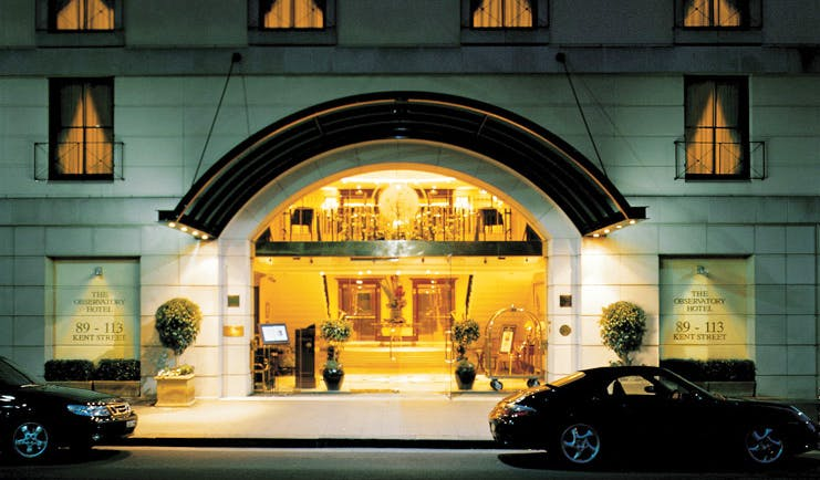 The Langham Sydney exterior white building with large glass entrance
