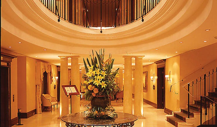 The Langham Sydney lobby area with columns and staircase