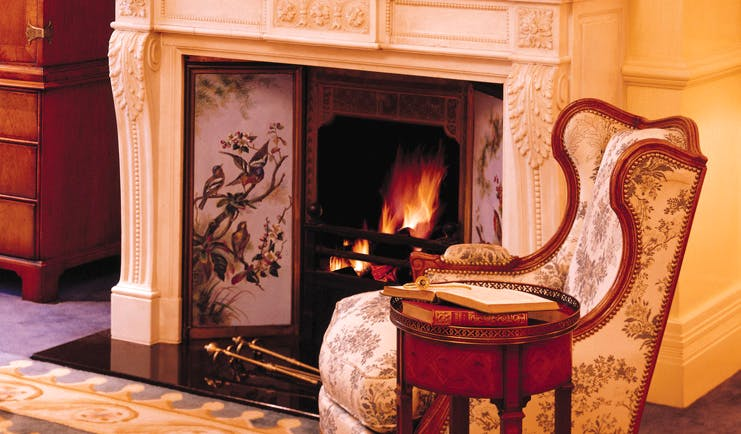 The Langham Sydney lounge ornate fireplace and antique chair
