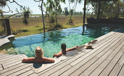 Bamurru plains lodge exterior, wooden deck, private pool overlooking outback