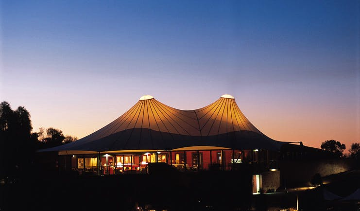 Longitude 131 Ayers Rock exterior large tent like building with floor to ceiling windows