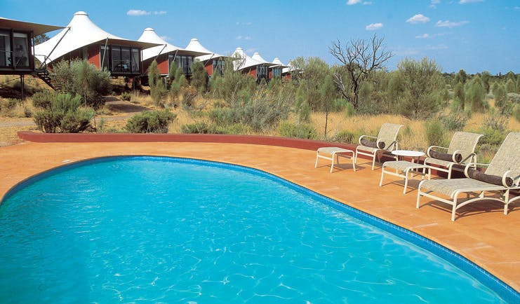 Longitude 131 Ayers Rock outdoor pool lodges overlooking outdoor pool with loungers