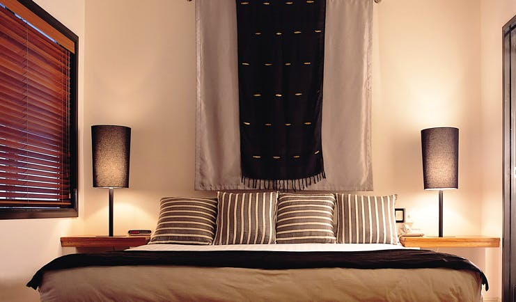 Alamanda Palm Cove Queensland bedroom with wall hanging