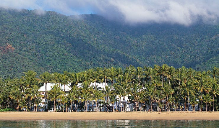 Alamanda Palm Cove Queensland exterior beach with rainforest and white building surrounded by trees