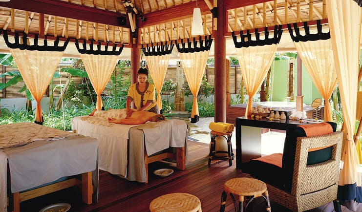 Alamanda Palm Cove Queensland spa person getting massage in covered outdoor spa