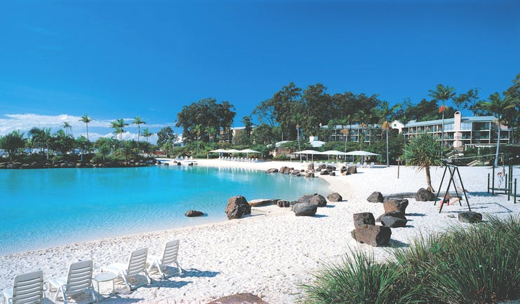 Intercontinental Sanctuary Cove lagoon with blue waters and white sand
