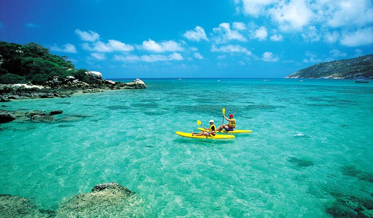 Lizard Island Queensland kayaking two people kayaking in clear blue water