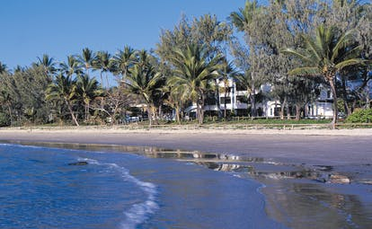 Port Douglas Peninsula Queensland beach front white building and palm trees near beach and sea