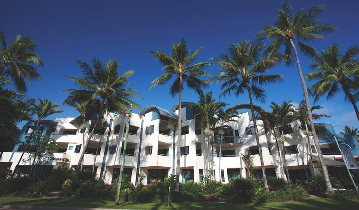 Port Douglas Peninsula Queensland exterior several white buildings with palm trees and blue sky