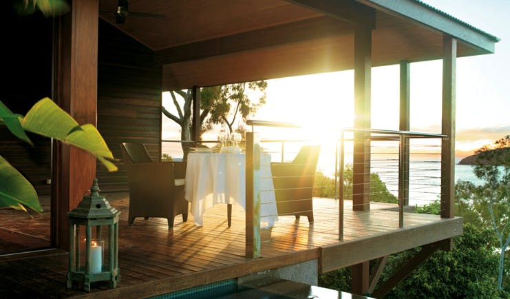 Qualia Hamilton Island Queensland outdoor dining area on covered deck with sea view
