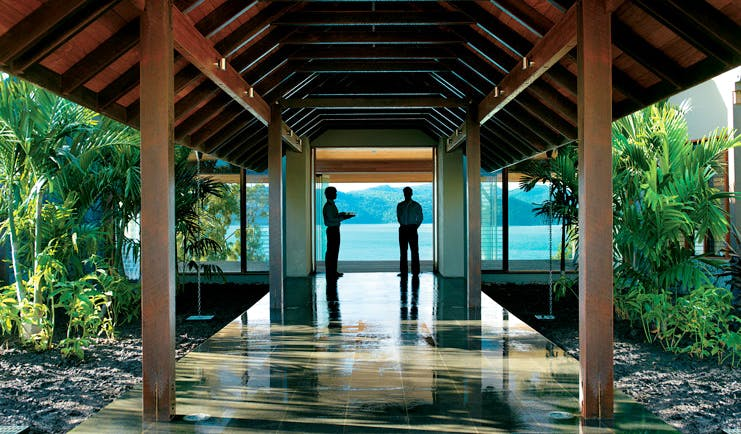 Qualia Hamilton Island Queensland pavilion waiters at the end of a covered pavilion with sea view