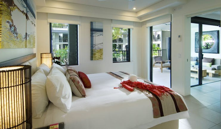 Sea Temple Queensland bedroom with artwork and view to sitting room