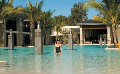 Sea Temple Queensland lagoon pool with columns and palm plants