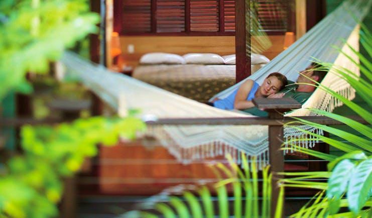 Silky Oaks Lodge Queensland hammock couple sleeping in a hammock together