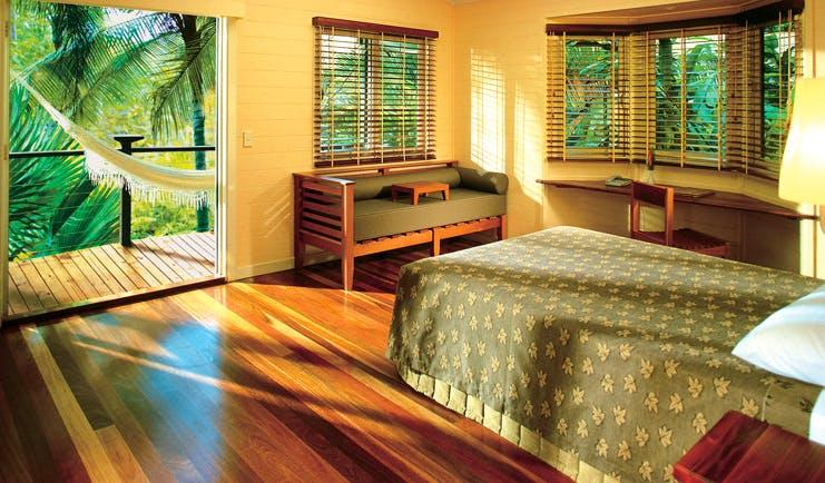 Silky Oaks Lodge Queensland bedroom with door to balcony with hammock