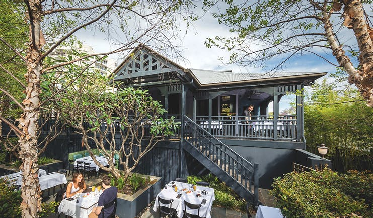Spicers Balfour restaurant with outdoor seating area amongst trees