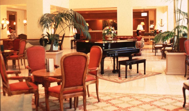 Stamford Plaza Brisbane Queensland lobby with seating area and grand piano