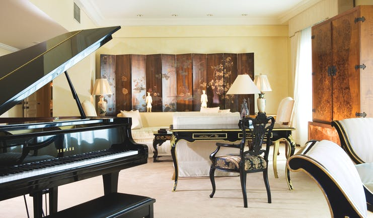 Stamford Plaza Brisbane Queensland suite lounge with sofas desk and grand piano