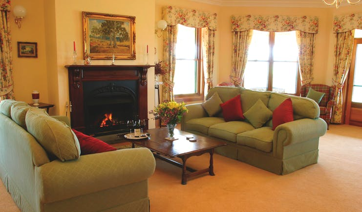 Abbotsford Country House South Australia lounge with sofas and armchairs and fireplace