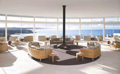 Lounge area with lagre window pannelled walls looking over the sea and seatings area