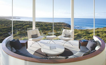 Southern Ocean Lodge osprey pavilion lounge, modern seating area with panoramic views over coastline and sea
