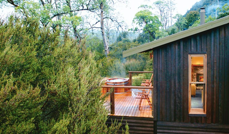 Cradle Mountain Lodge Tasmania balcony hot tub wood cabin with decked balcony with hot tub and forest view