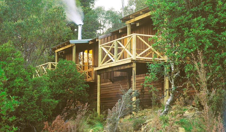 Cradle Mountain Lodge Tasmania cabin balcony two wood cabins with balconies in the forest