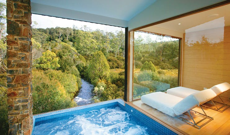 Cradle Mountain Lodge Tasmania pool view private swimming pool with view of river and loungers