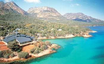 Aerival view over Freycinet Lodge shown near the sea and mountains