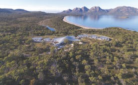 Saffire Freycinet Tasmania aerial view of a futuristic building in wooded area near the coast