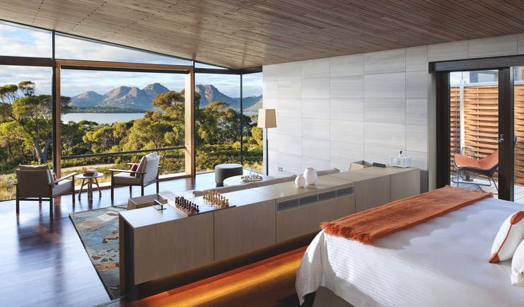 Saffire Freycinet Tasmania deluxe suite with floor to ceiling windows and seating area with mountain view