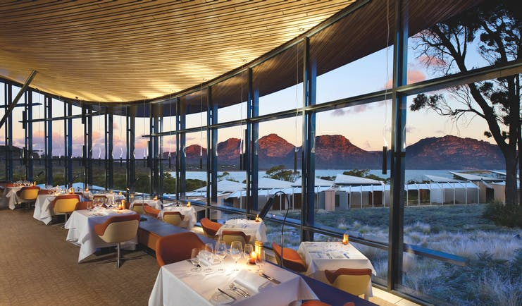 Saffire Freycinet Tasmania dining restaurant with floor to ceiling windows and mountain view