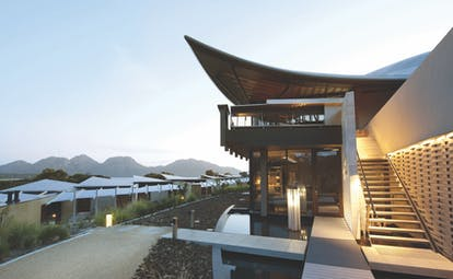 Saffire Freycinet Tasmania exterior view of futuristic building with staircase leading to it