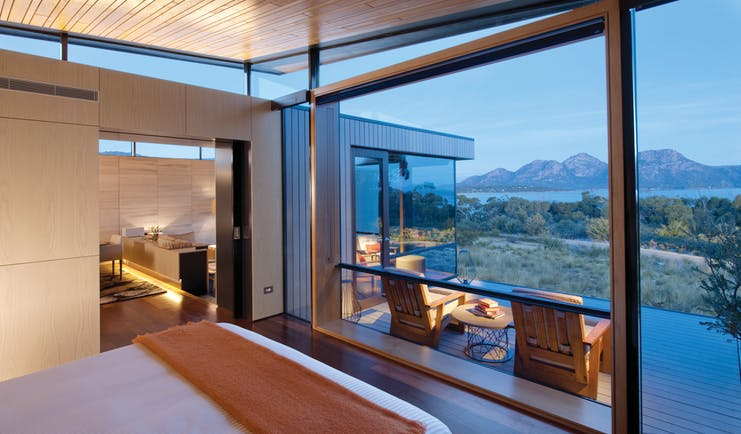Saffire Freycinet Tasmania premium suite with large windows leading to deck with mountain and sea view