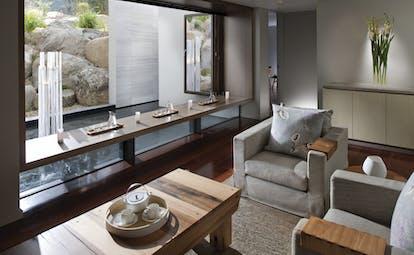 Saffire Freycinet Tasmania spa lounge area with tea set and fountain view